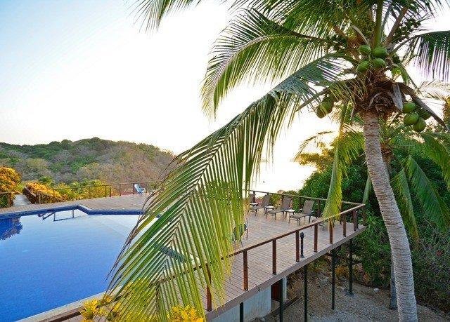 sky tree plant property palm Resort caribbean arecales palm family swimming pool Beach tropics Villa