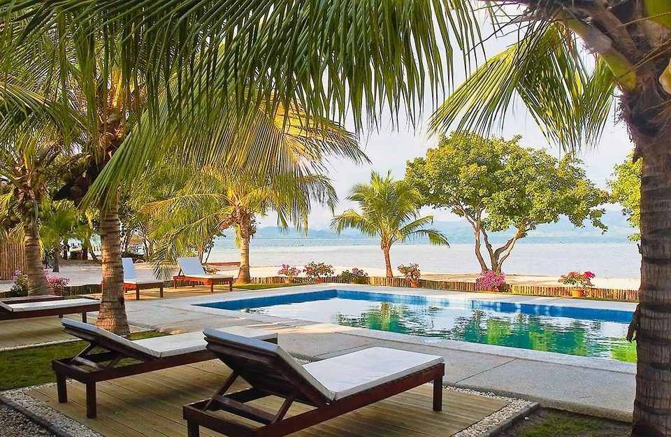 tree water leisure property Resort Beach palm swimming pool arecales caribbean Villa plant lined