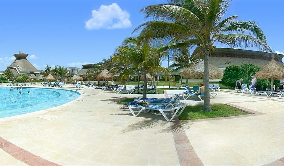 sky ground swimming pool property leisure Resort caribbean Beach walkway Villa resort town condominium arecales shore sandy