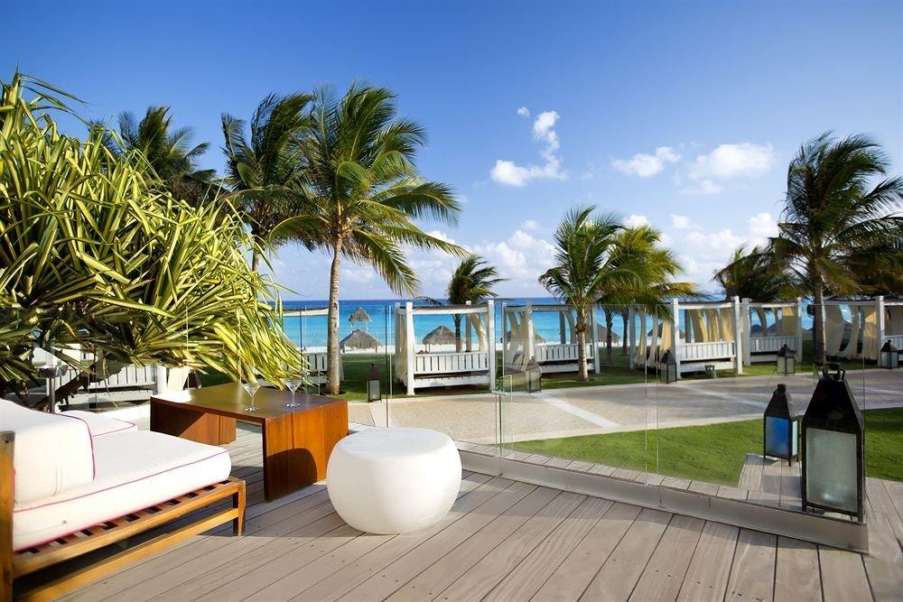 tree sky leisure property Resort condominium arecales walkway caribbean Beach Villa swimming pool plant