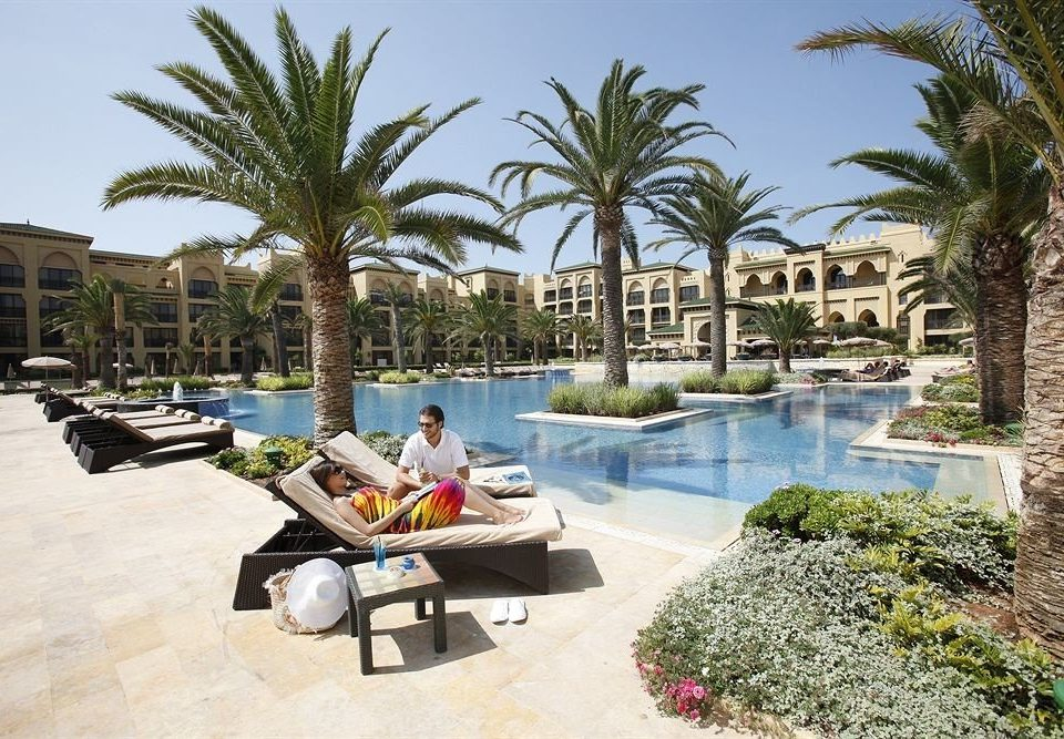 tree leisure property Resort swimming pool building palm arecales Villa condominium home Beach plant