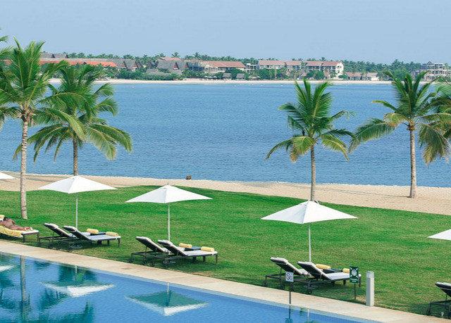 palm tree leisure property swimming pool Resort caribbean arecales condominium plant marina dock Beach palm family Villa lined