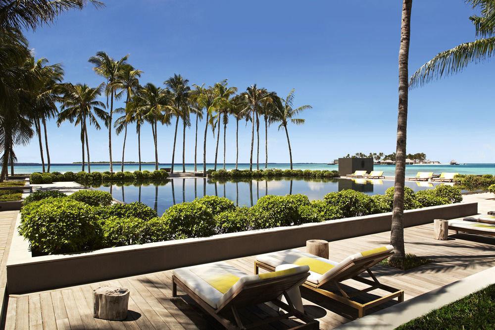 sky tree leisure palm property building Resort condominium park arecales Beach Villa home swimming pool dock walkway lined