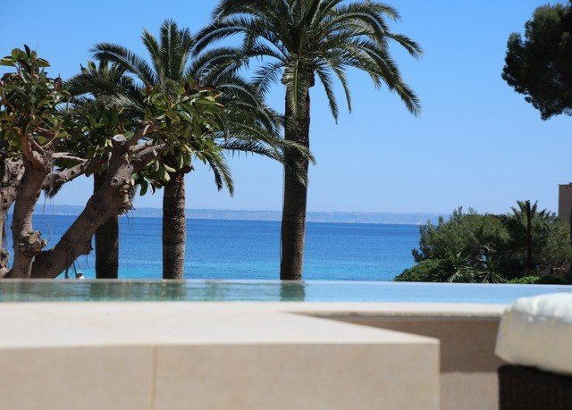 tree sky palm property Beach swimming pool arecales Resort caribbean Villa condominium shore plant