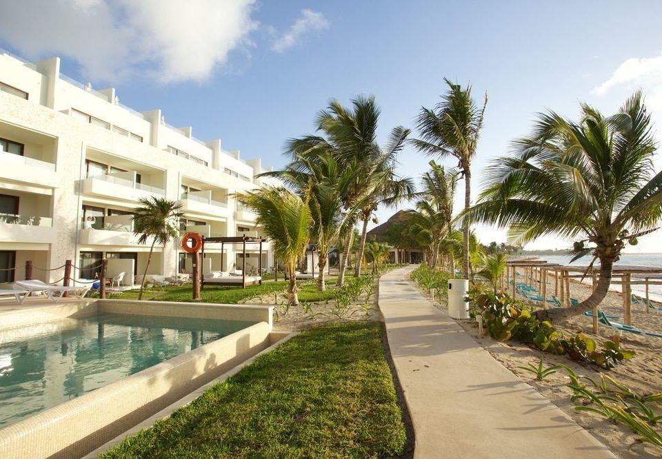 sky grass property condominium Resort walkway plaza arecales residential area swimming pool Beach Villa palace marina