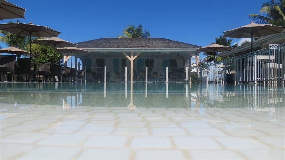 building house property swimming pool walkway Resort home condominium Villa Beach mansion