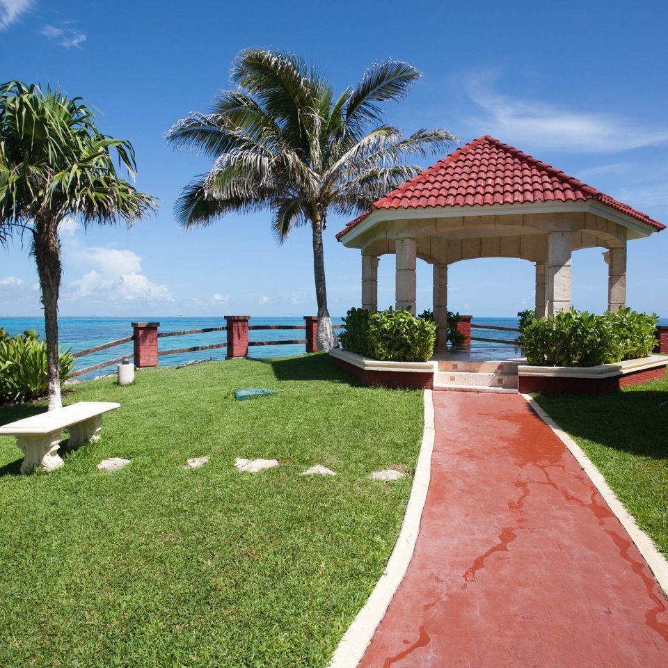 grass sky tree lawn Beach Resort palm Villa walkway caribbean plant