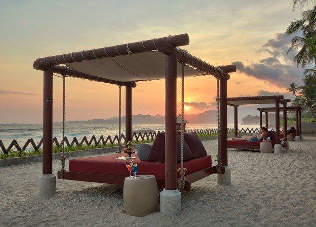sky water property Beach Villa hacienda Resort outdoor structure day shore