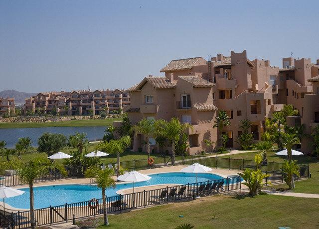 sky grass property Resort residential area Beach condominium Villa Village