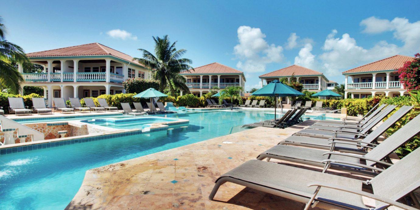 sky leisure Resort property swimming pool dock marina resort town Beach caribbean condominium Water park