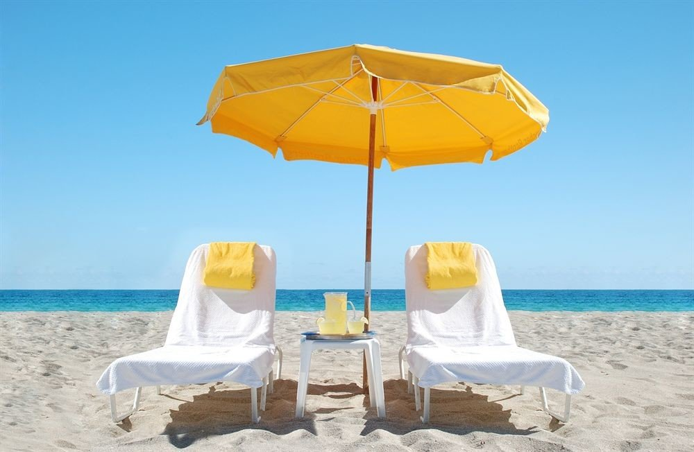 sky umbrella chair water leisure Beach yellow fashion accessory accessory swimming pool lawn Sea empty shore day sandy