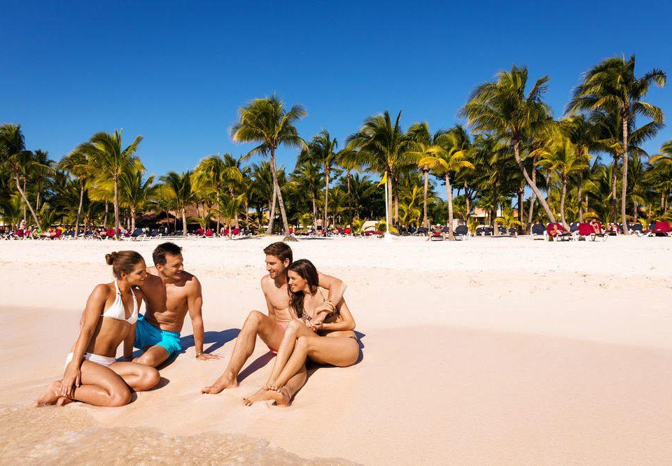 sky Beach tree leisure swimsuit caribbean palm sand Sea laying sun tanning Water park shore swimming sandy