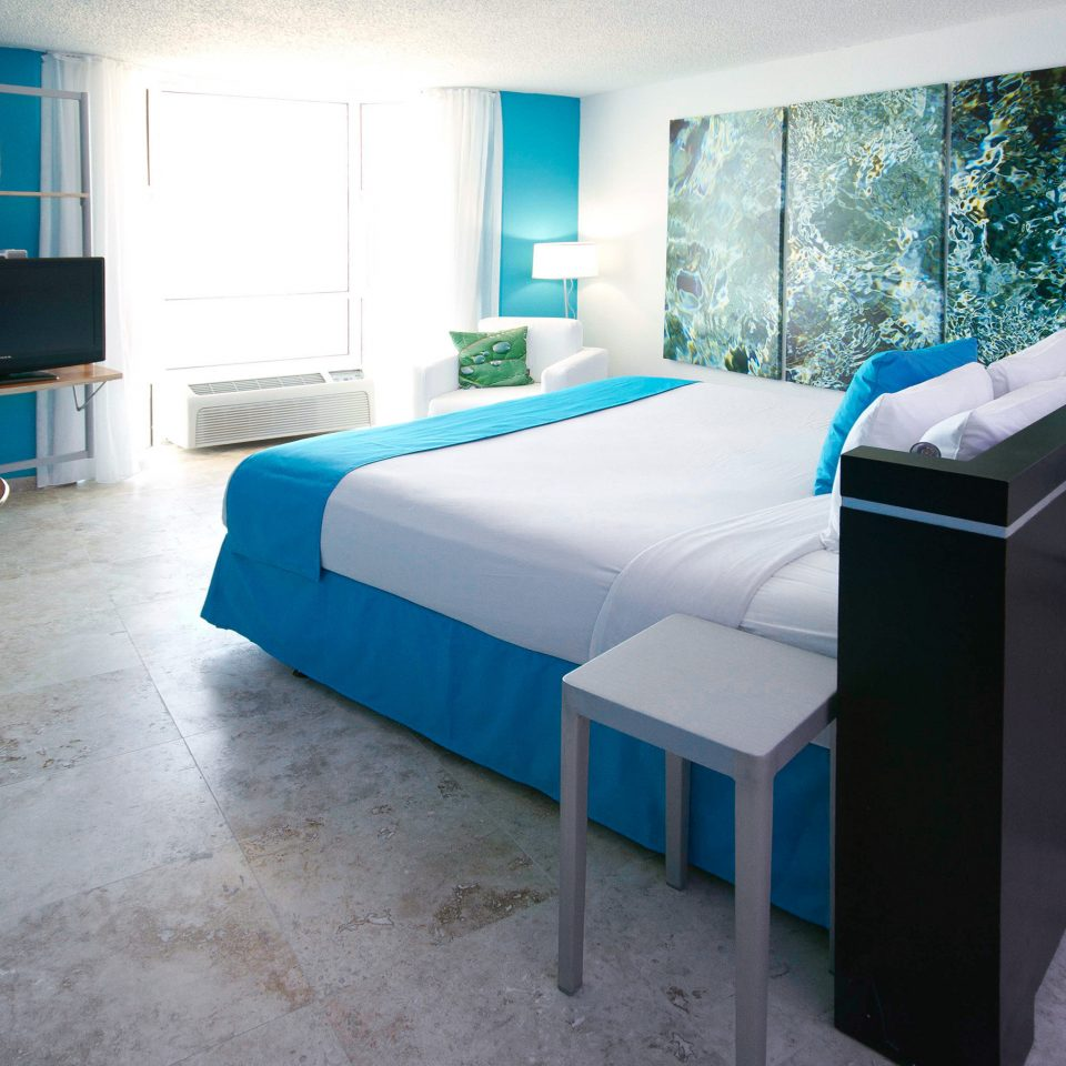 Beachfront Bedroom Boutique Budget City Island Modern property swimming pool blue Suite