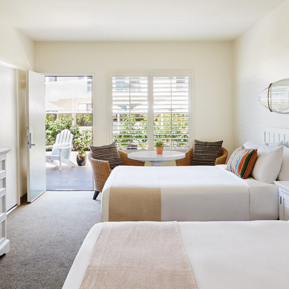 Beachfront Bedroom Boutique Hip property living room home white cottage nursery Suite Modern