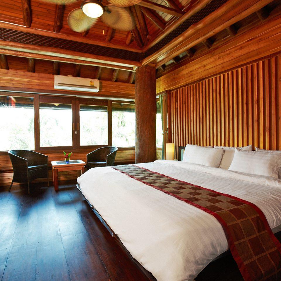 Beachfront Bedroom Classic sofa property building vehicle cottage Resort log cabin home Suite