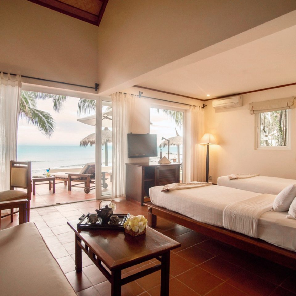 Beachfront Bedroom Cultural Jungle Ocean Patio Resort Scenic views Spa Terrace Tropical Waterfront property Suite Villa living room condominium cottage
