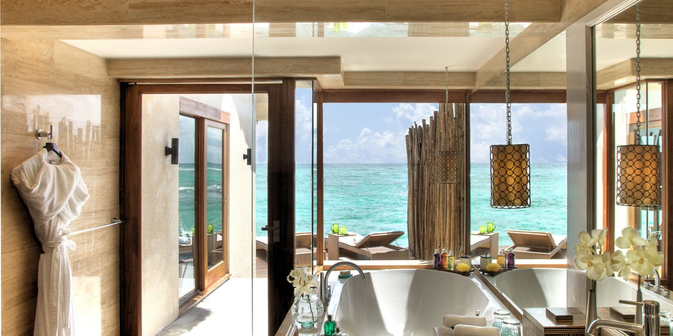 Beachfront Bedroom Family Hotels Resort Scenic views Villa property home sink swimming pool bathroom restaurant Suite tub Island