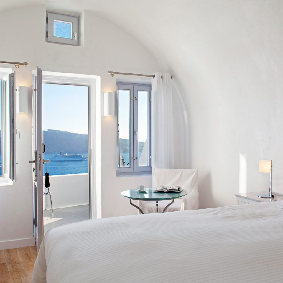 Beachfront Bedroom Greece Hotels Luxury Modern Romance Santorini Scenic views Suite property white scene cottage Villa