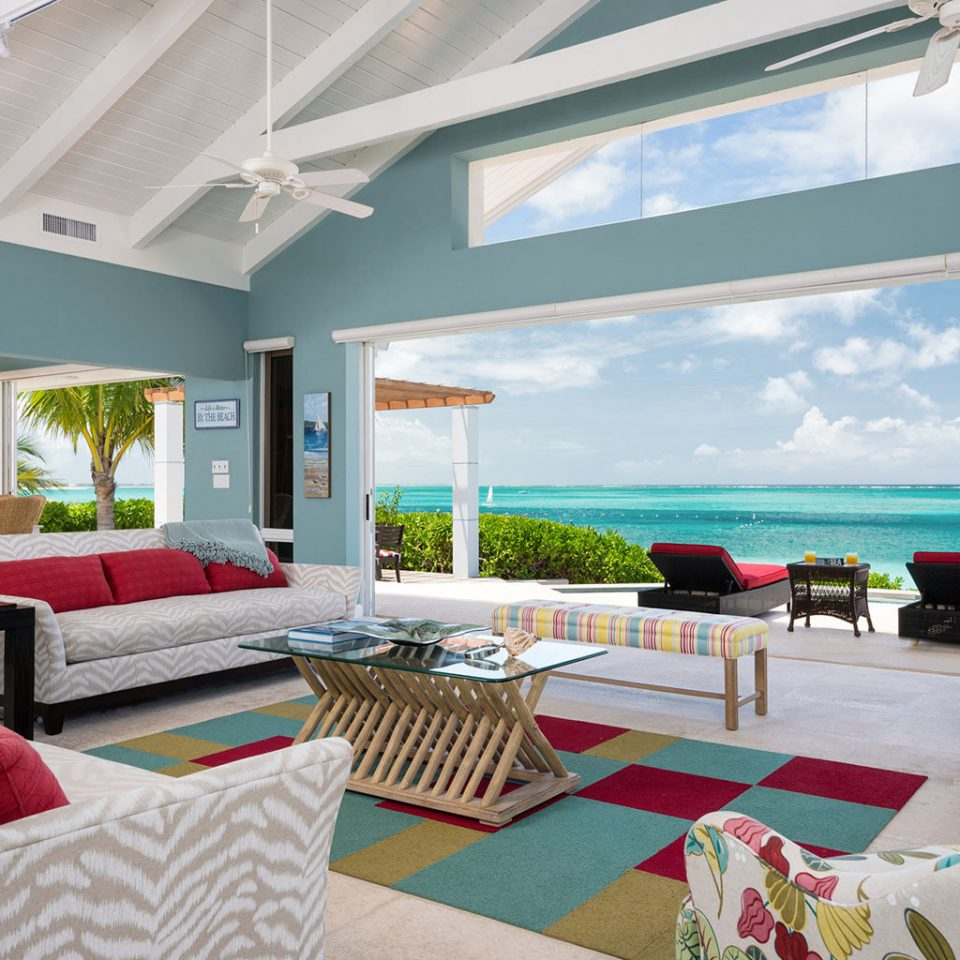 Beachfront Grounds Resort property Villa home living room cottage condominium Suite colorful Bedroom