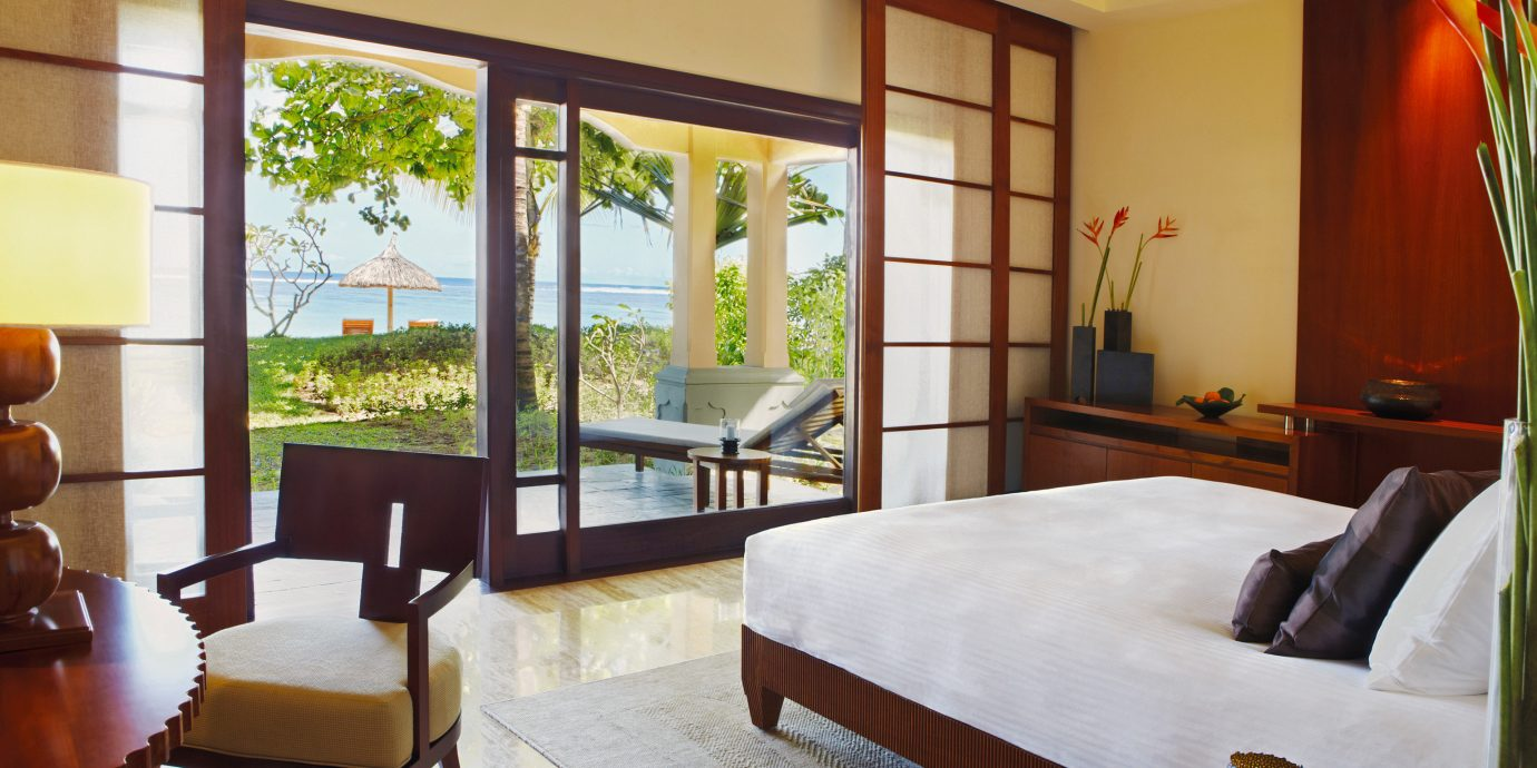 Beachfront Bedroom Island Luxury Romance Romantic property home living room Suite Resort Villa condominium cottage