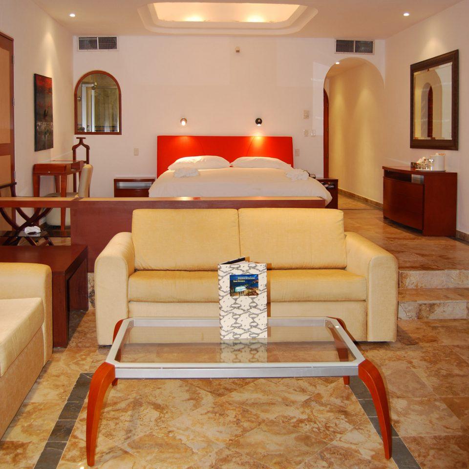 Beachfront Bedroom Luxury Waterfront property living room hardwood home flooring Lobby wood flooring Suite