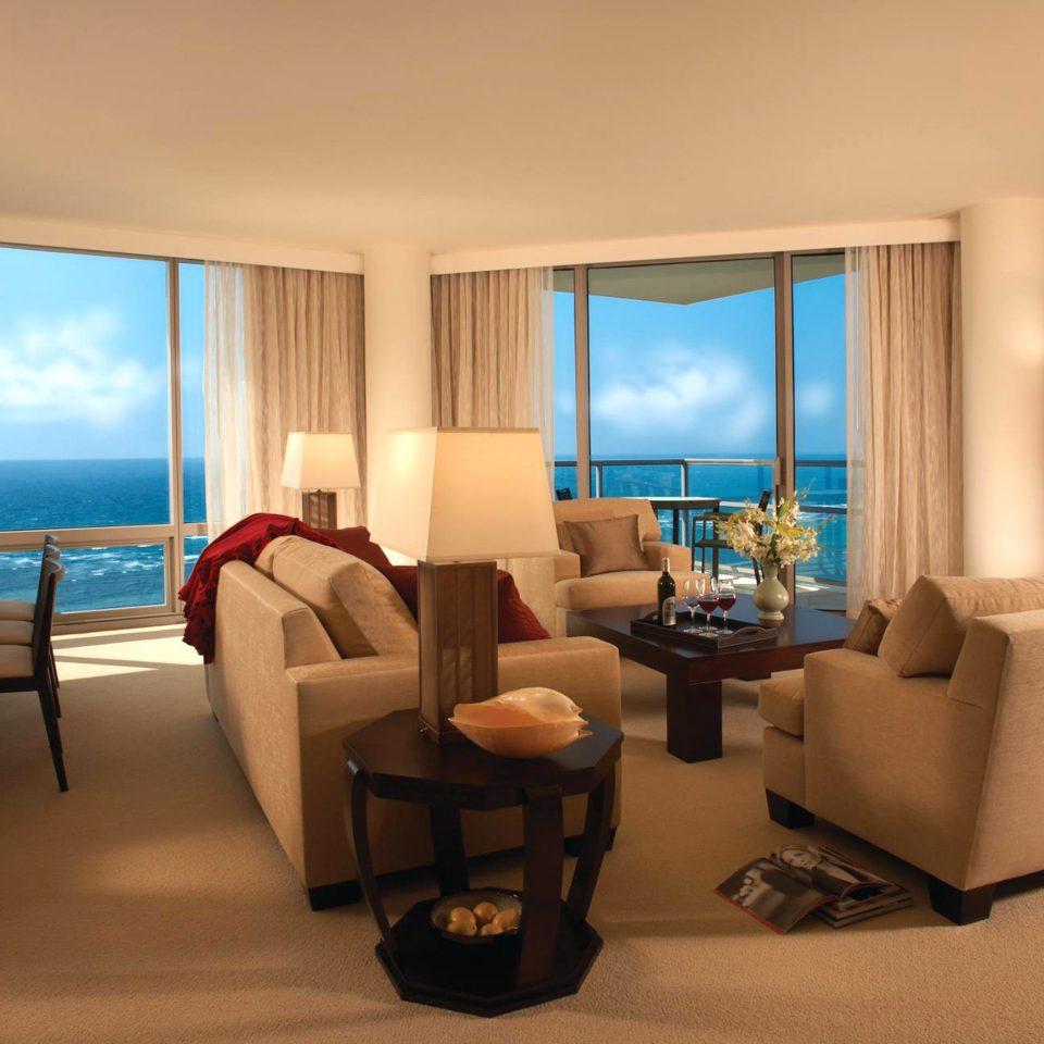 Beachfront Luxury chair property condominium Suite living room Ocean nice home Resort overlooking Villa Bedroom flat Modern