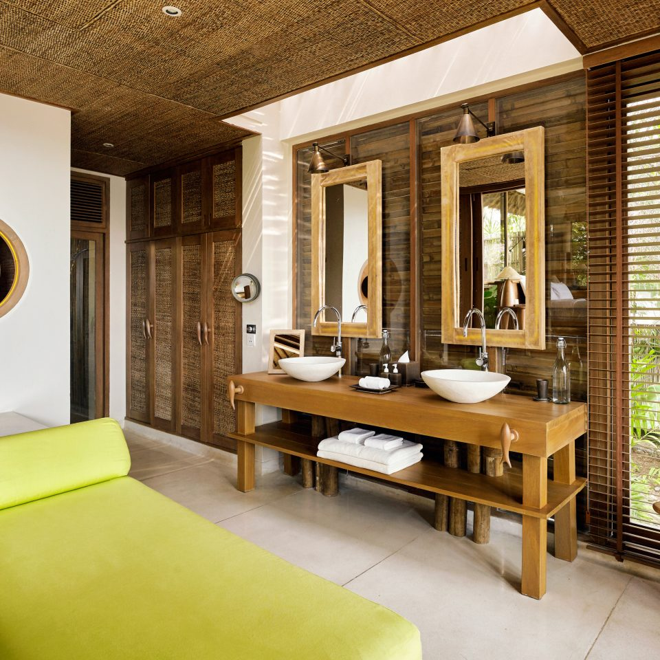 Beachfront Luxury Ocean Romantic Scenic views Spa property yellow condominium home living room Suite Villa Bedroom