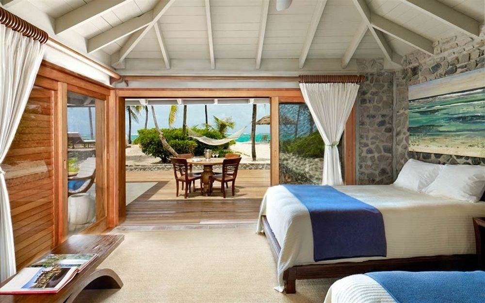 Beachfront Bedroom Luxury Resort property home cottage Villa Suite living room swimming pool