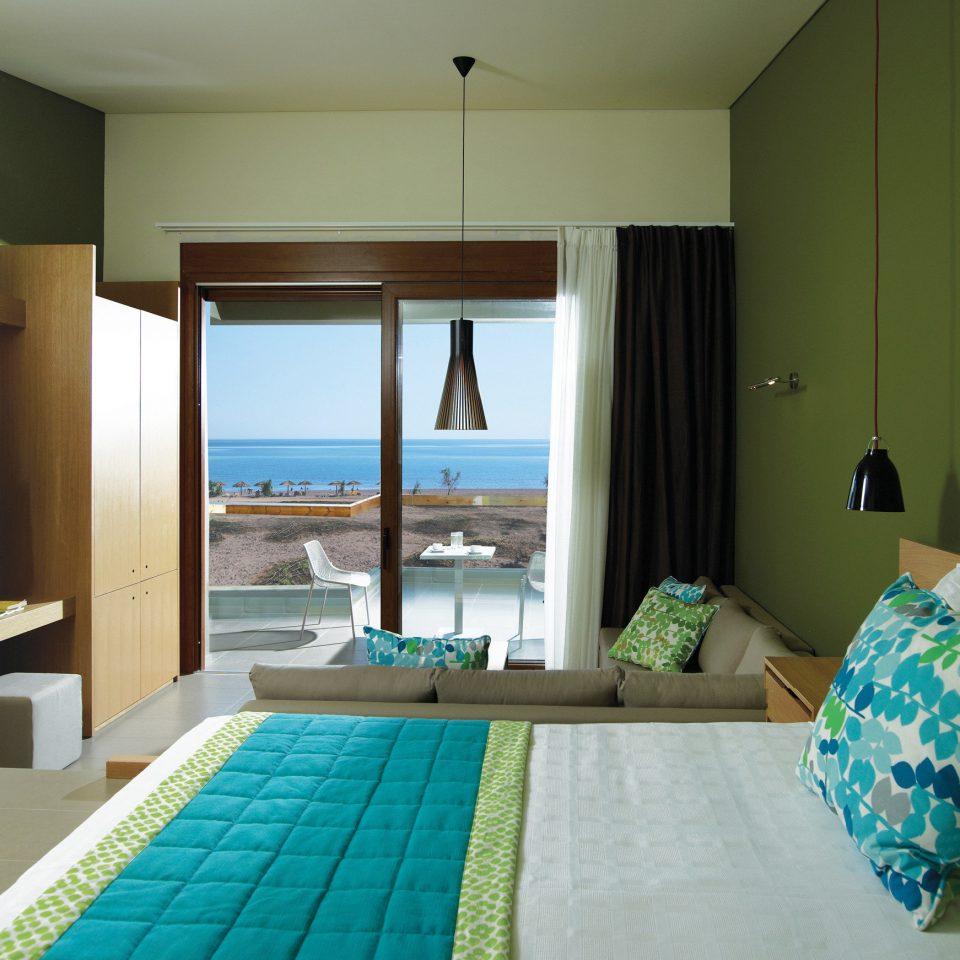 Beachfront Bedroom Modern Patio Resort Scenic views property condominium Suite cottage home green