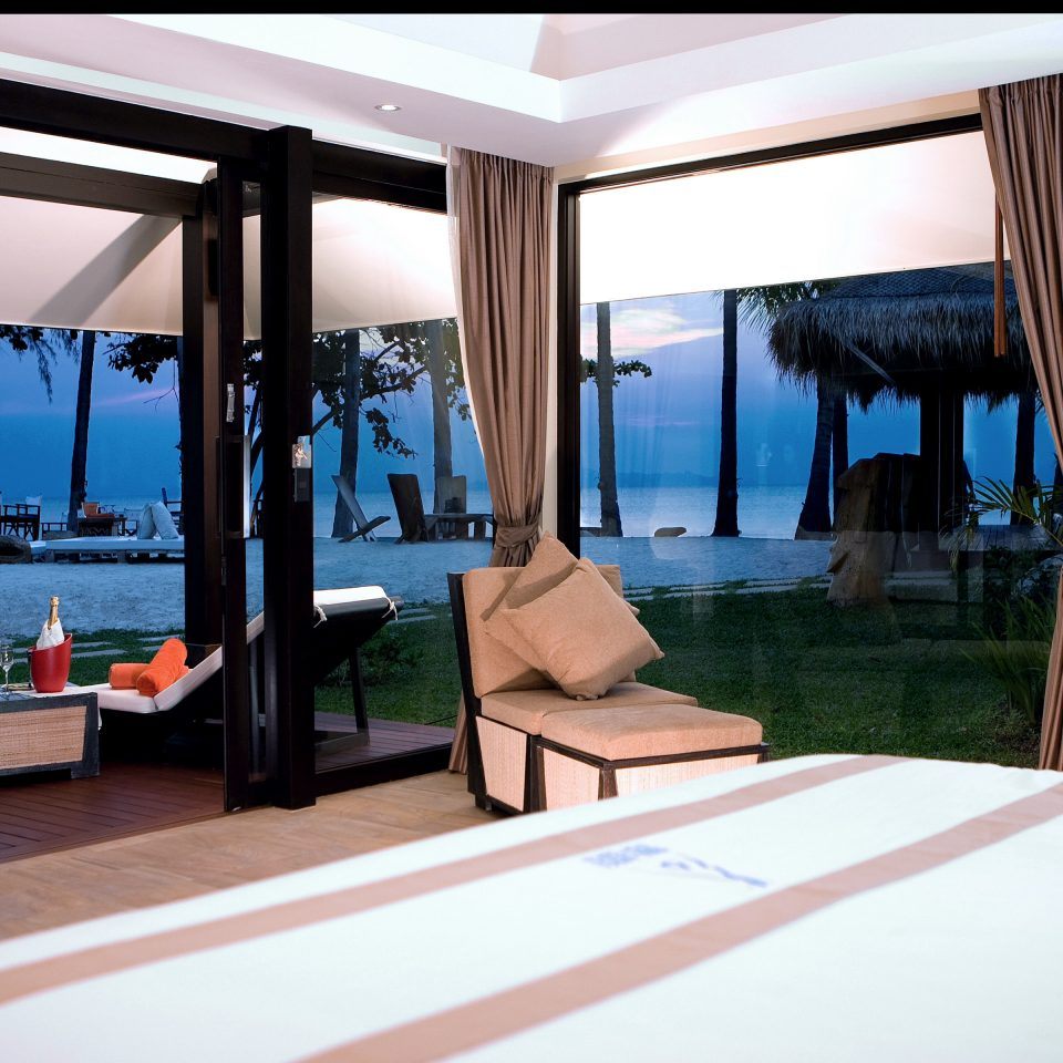Beachfront Bedroom Modern Resort Suite property condominium home Villa living room swimming pool overlooking