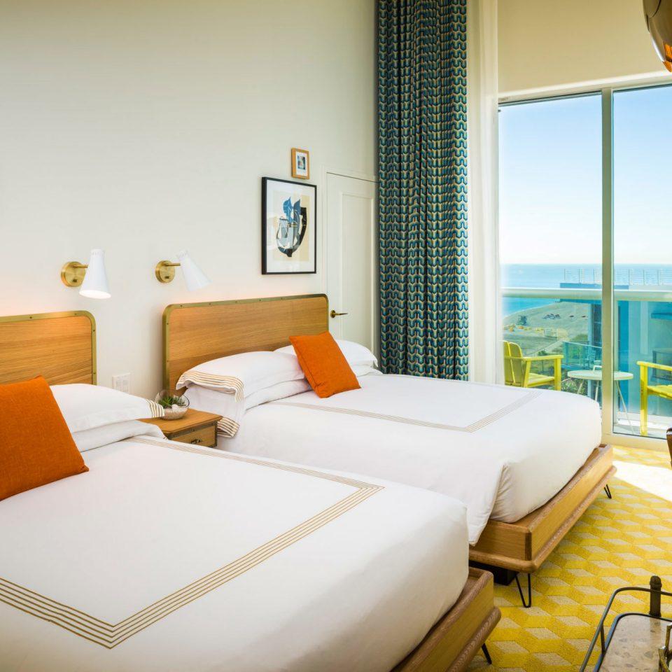 Beachfront Bedroom Modern Resort Scenic views property Suite condominium cottage bed sheet Villa