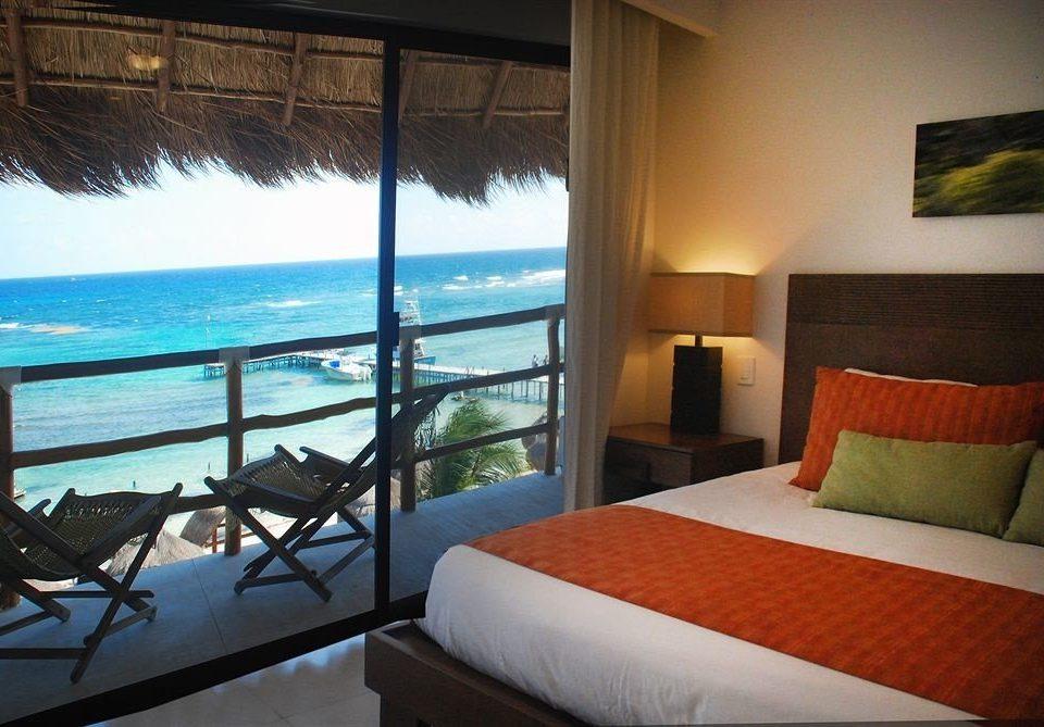Beachfront Bedroom Ocean Scenic views Tropical property building Resort Villa Suite cottage condominium overlooking