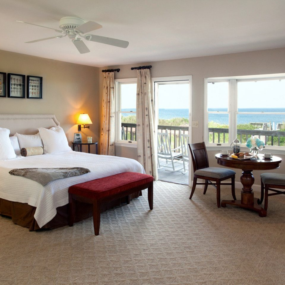 Beachfront Bedroom Resort Scenic views Waterfront property chair living room Suite condominium home Villa hardwood cottage