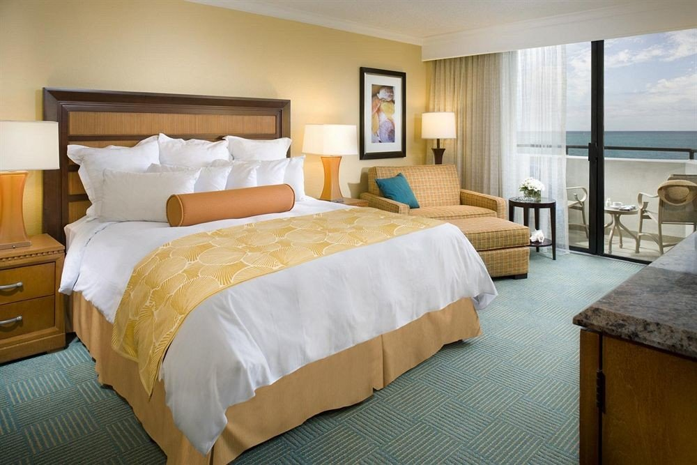Beachfront Bedroom Resort property Suite cottage wooden bed sheet night