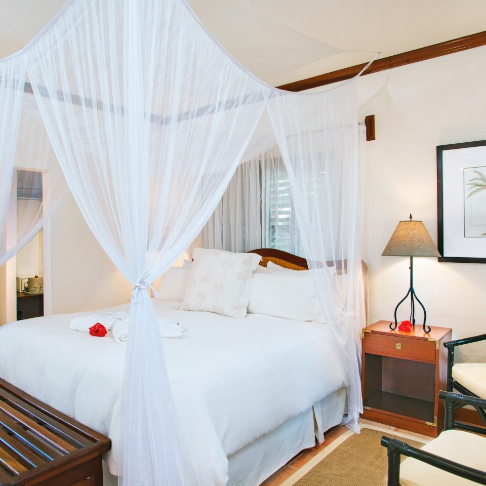 Beachfront Bedroom Resort property Suite cottage mosquito net Villa