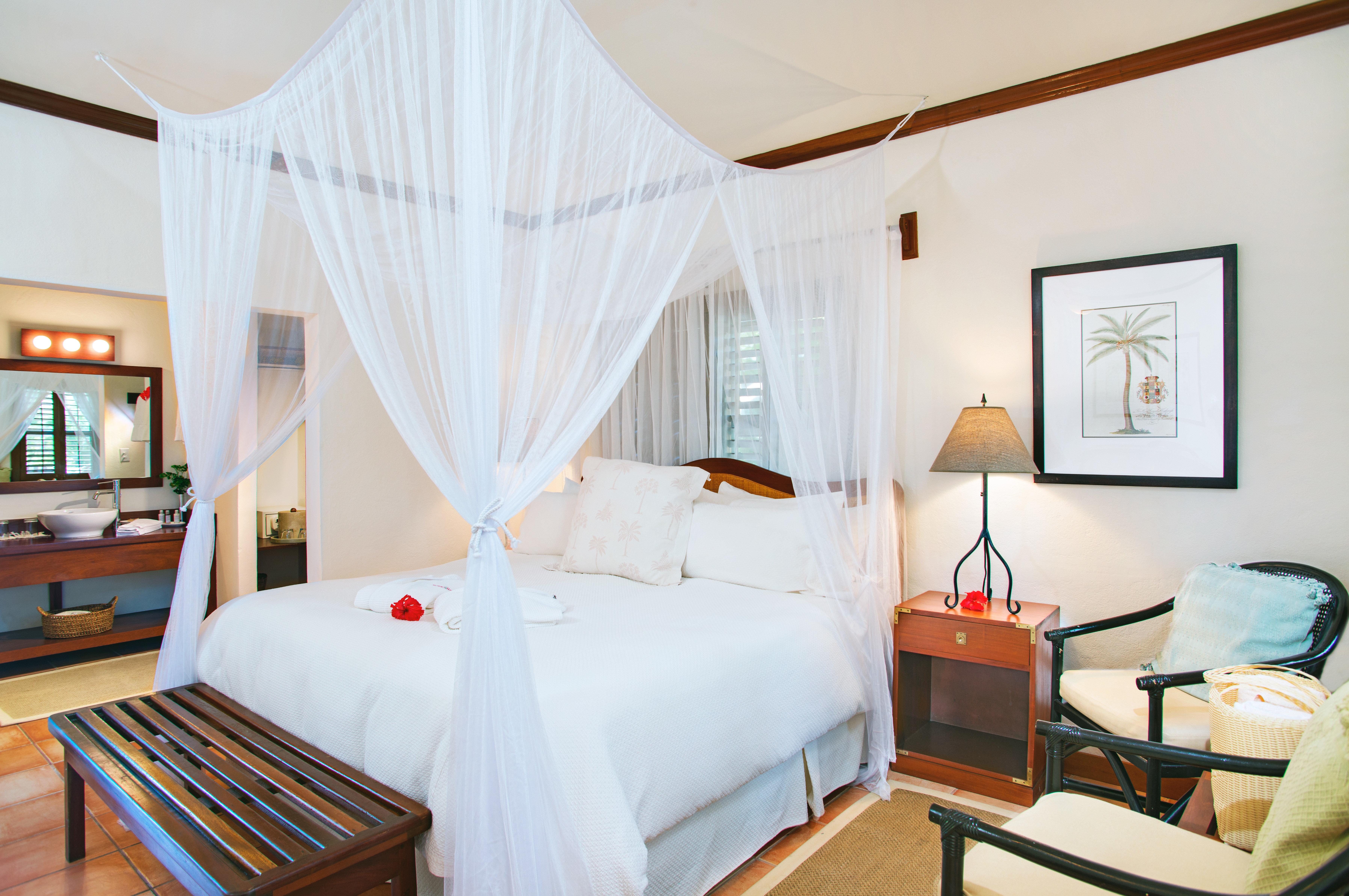 Beachfront Bedroom Resort property Suite cottage mosquito net Villa
