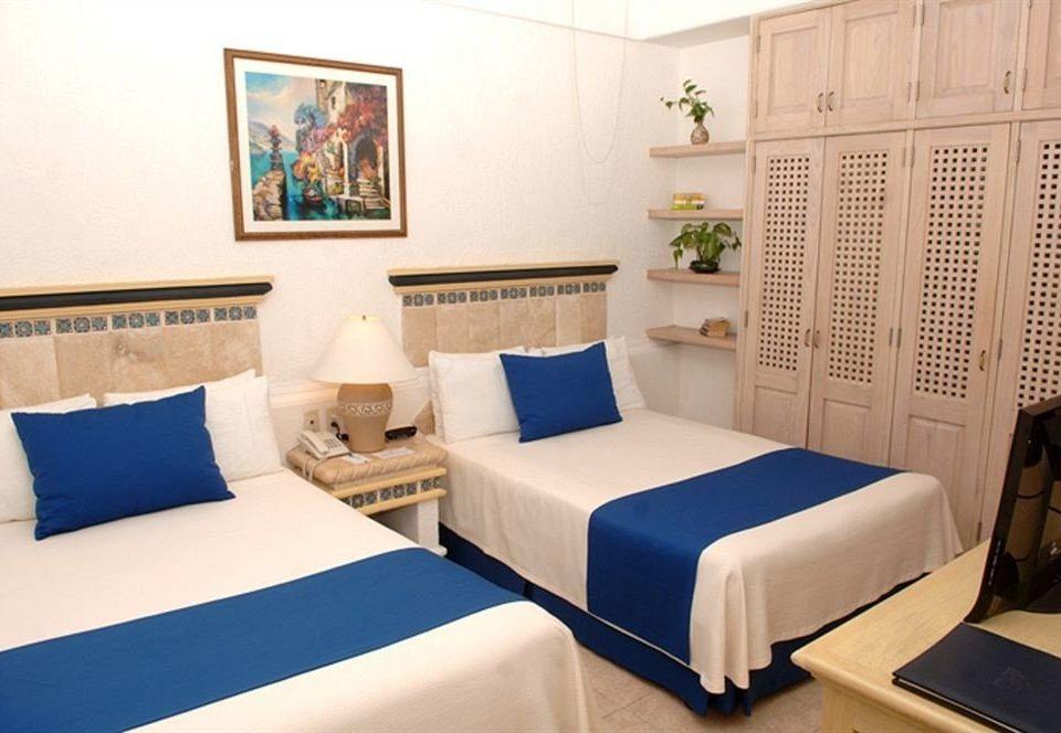 Beachfront Bedroom Resort property Suite cottage living room bed sheet blue