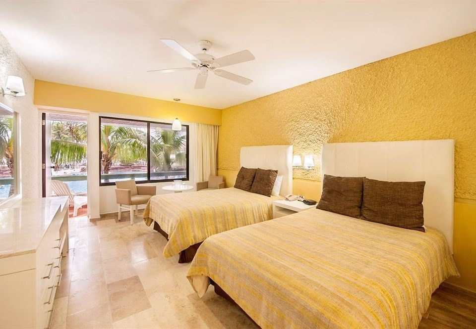 Beachfront Bedroom Resort property Suite yellow cottage Villa