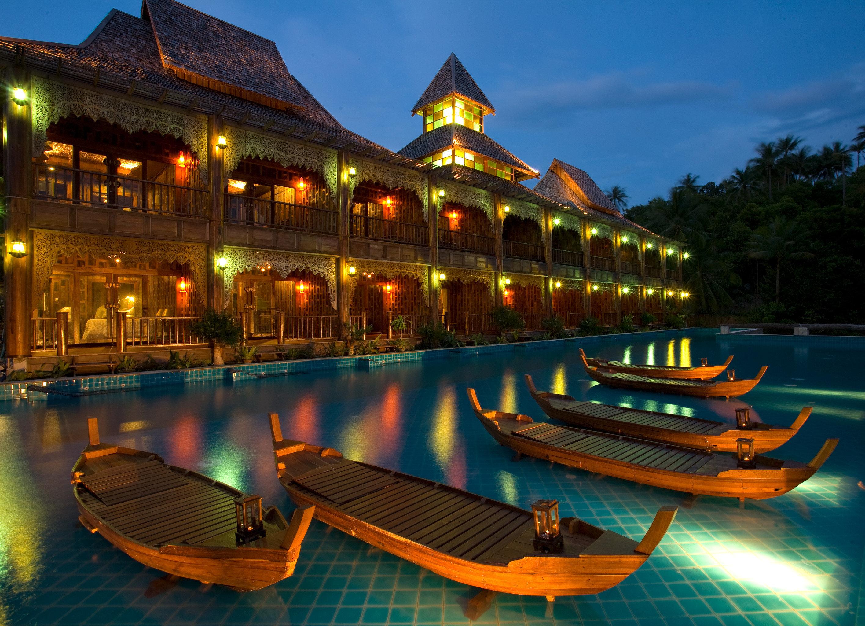 Beachfront Boat Exterior Honeymoon Jungle Pool Romance Romantic Tropical Waterfront sky water Resort evening vehicle