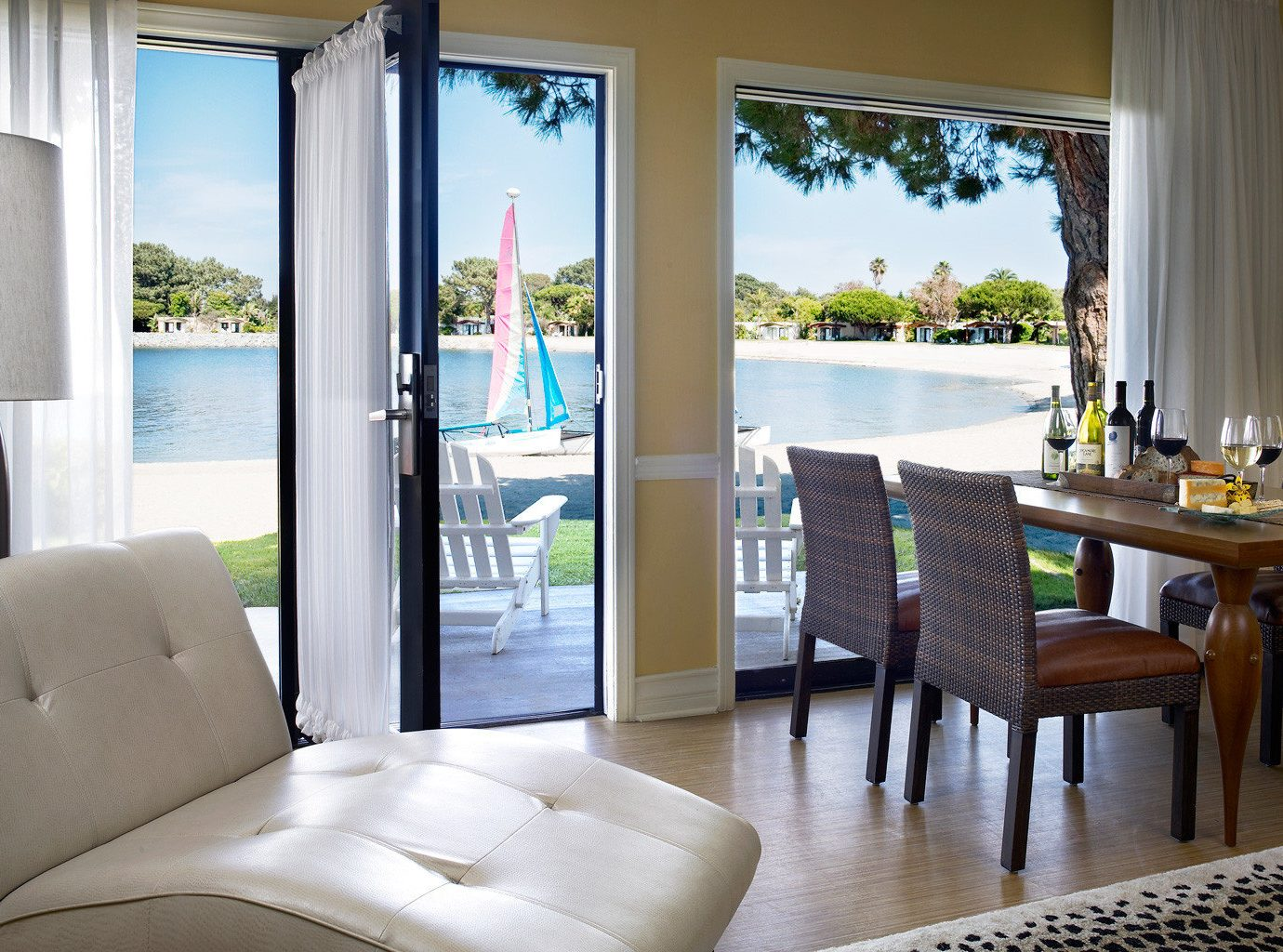 Beachfront Boat Ocean Patio Resort Terrace property home living room condominium cottage porch Villa Suite