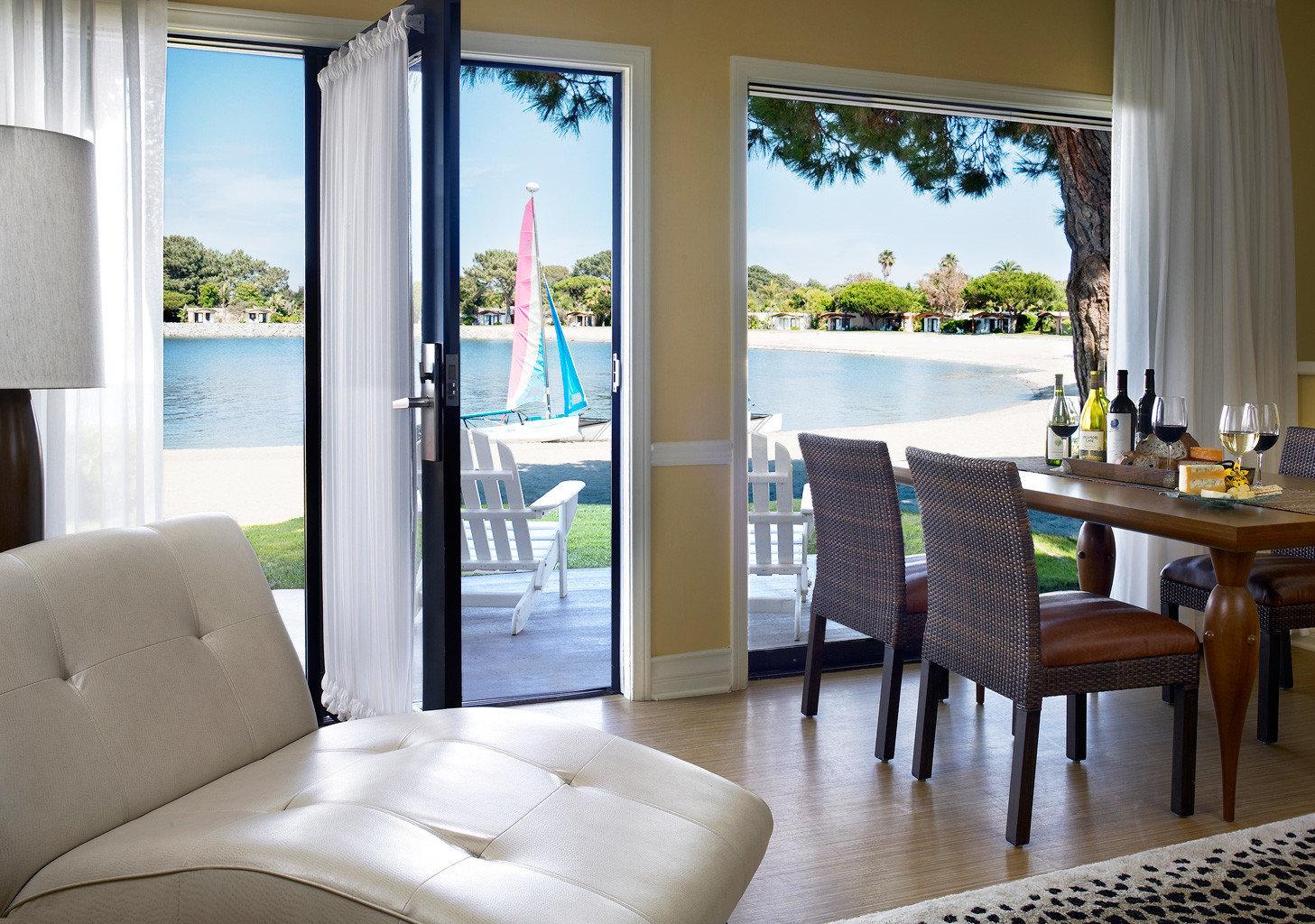 Beachfront Boat Ocean Patio Resort Terrace property home living room condominium cottage porch Villa Suite
