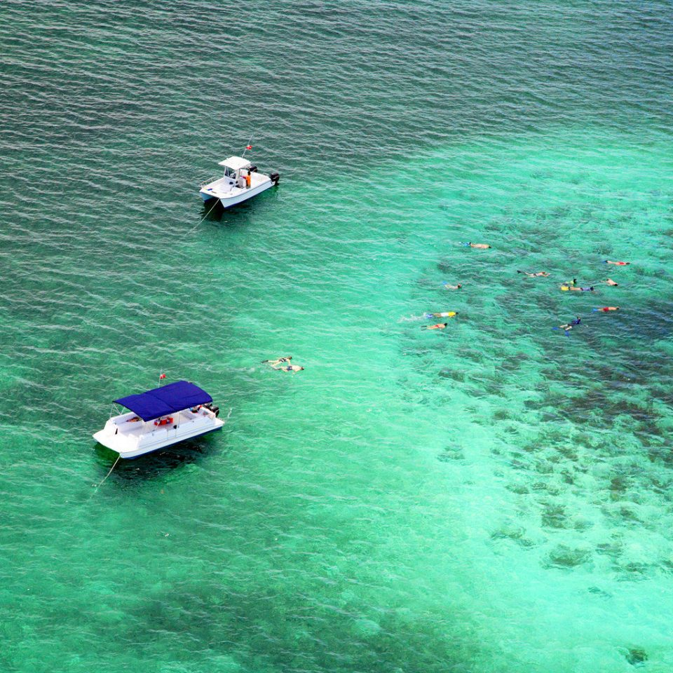 Beachfront Boat Waterfront water Sea floating Ocean underwater reef swimming surrounded