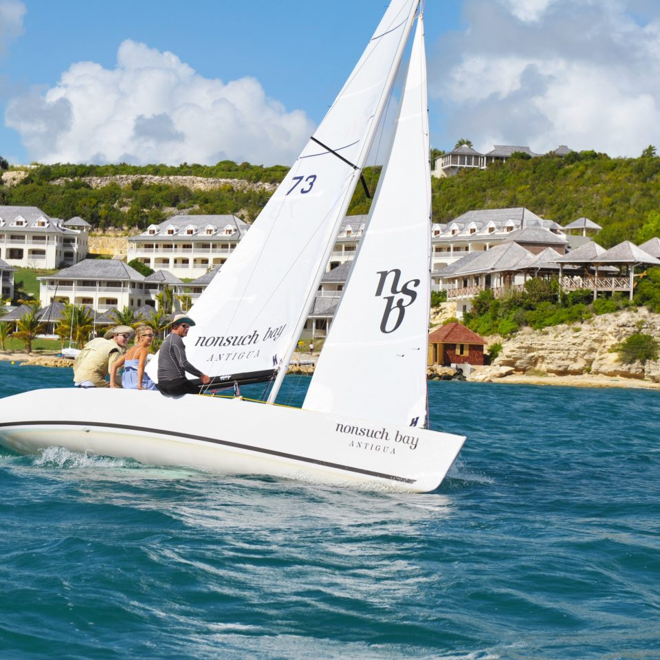 Beachfront Boat Outdoor Activities Outdoors Play Resort Scenic views sky water watercraft transport sailboat dinghy sailing sailing vehicle sail sailing vessel catamaran sailboat racing sports keelboat windsports dinghy skiff yacht racing yacht Sea wind ship
