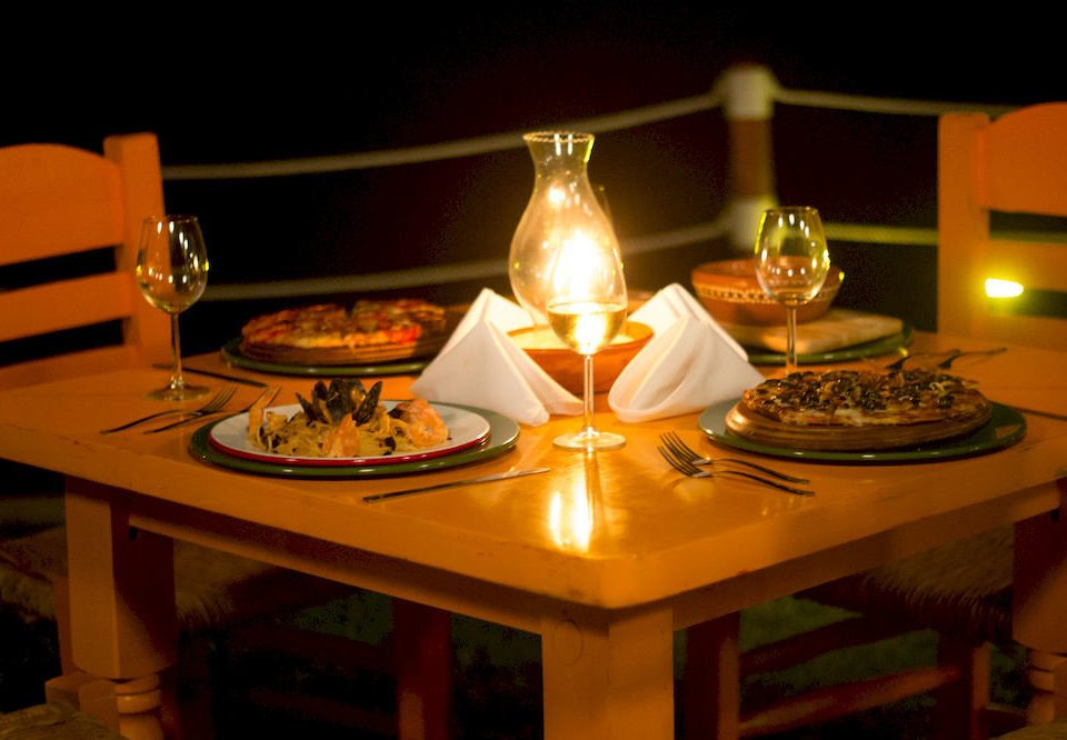 Beachfront Boutique Budget Dining Drink Eat Rustic Waterfront restaurant lighting dinner dining table