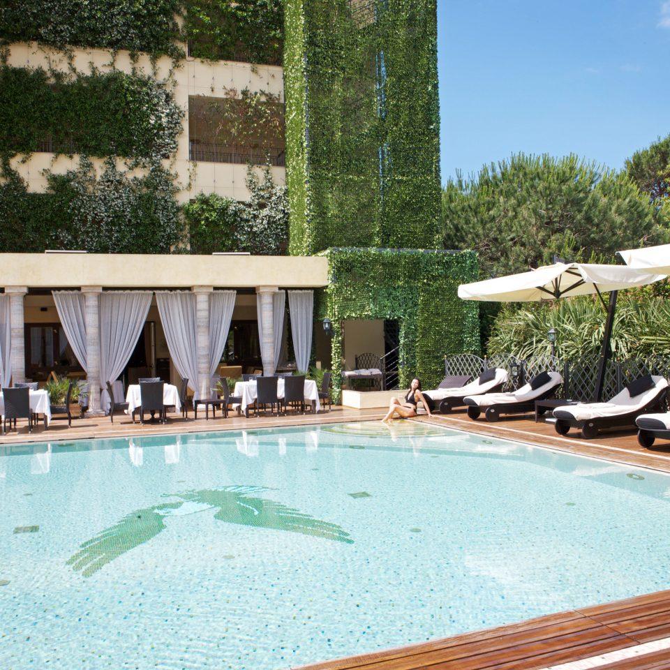 Beachfront Boutique Classic Pool tree swimming pool property leisure Villa Resort backyard condominium mansion