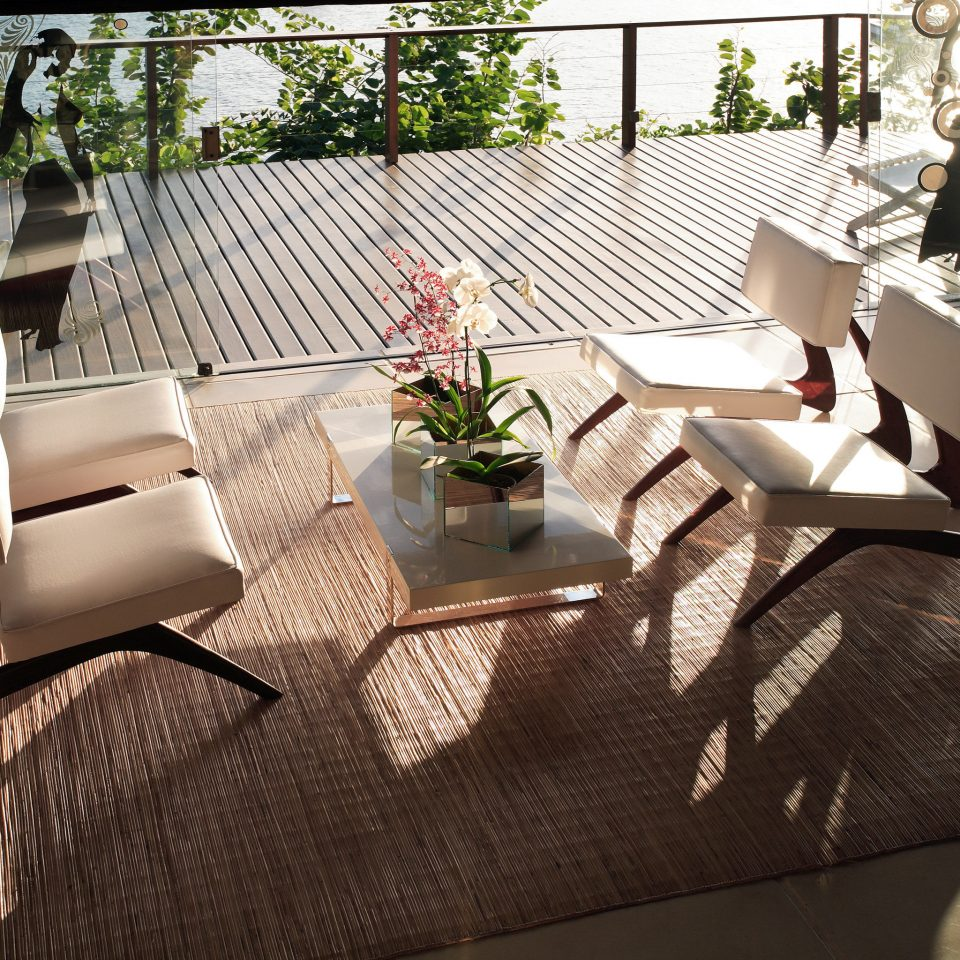 Beachfront Boutique Deck Lounge Patio Romantic Waterfront home living room