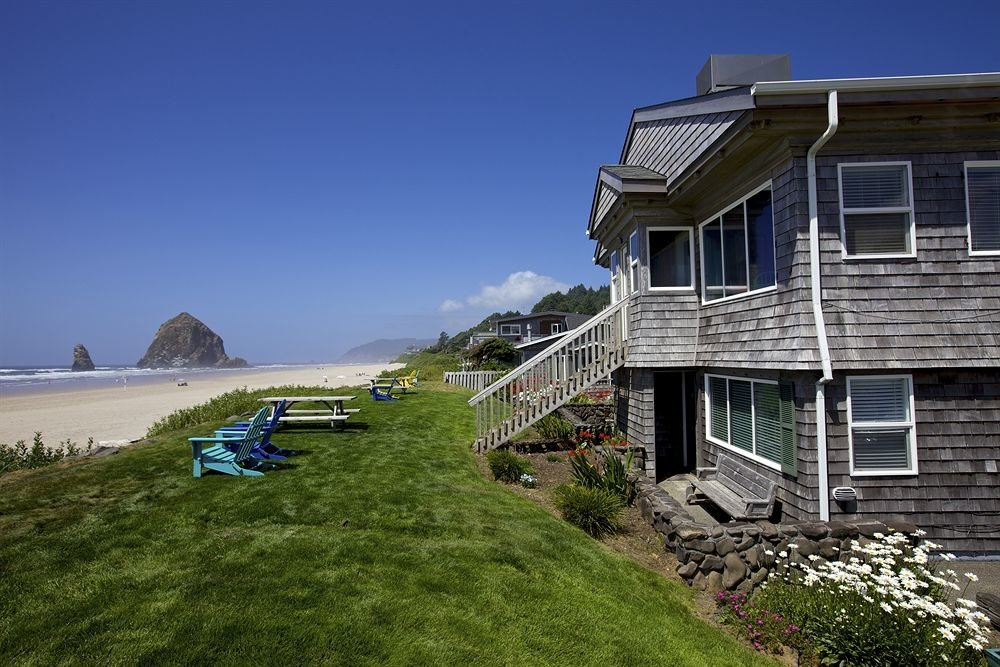 Beachfront Buildings Classic Exterior Island grass sky building property house residential area home cottage Coast lush