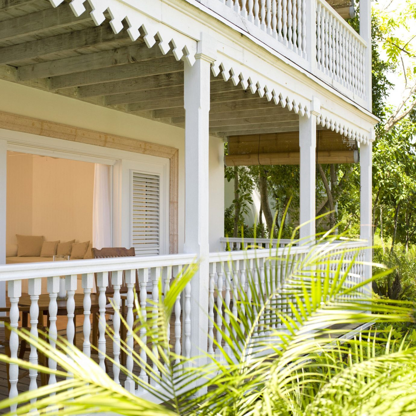 Beachfront Buildings Deck Luxury Resort building porch property house home yellow outdoor structure cottage backyard Villa