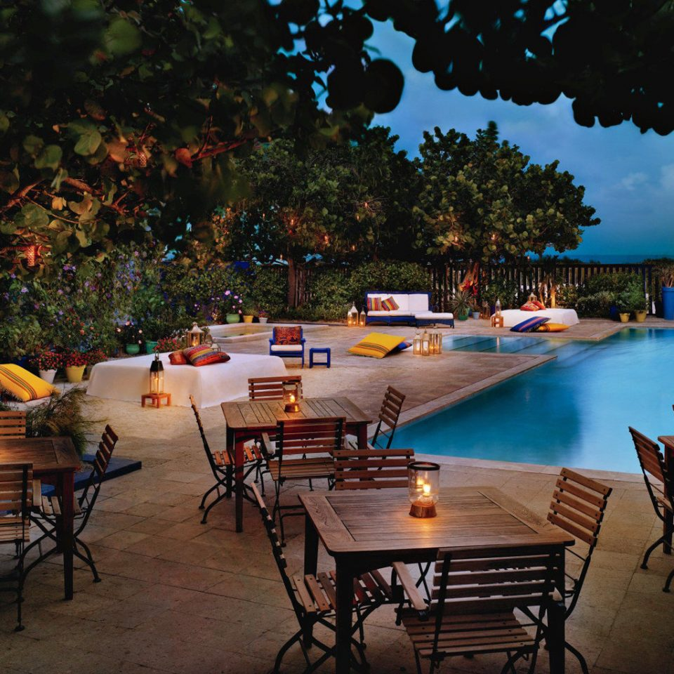 Beachfront Buildings Dining Drink Eat Exterior Grounds Honeymoon Luxury Nightlife Play Pool Resort Romance Waterfront tree chair leisure swimming pool backyard restaurant