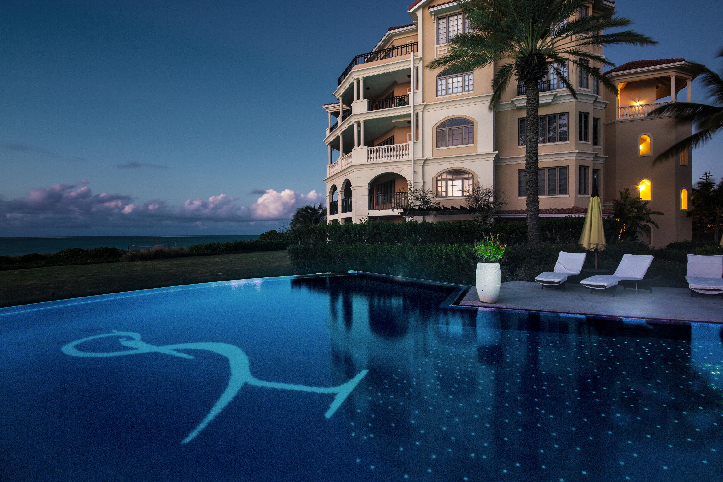 Beachfront Buildings Grounds Resort Scenic views water swimming pool house night mansion condominium